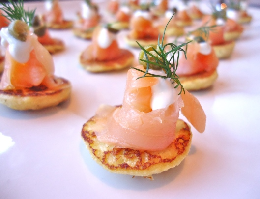 Potato blinis topped with smoked salmon, creme fraiche, capers & dill