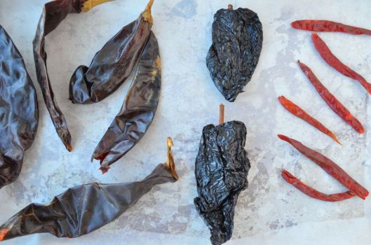 From left to right, chile guajillo (left), chile ancho (middle), chile de arbol (right)
