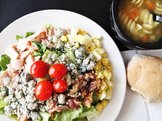 Cobb salad, chicken noodle soup and wheat roll.