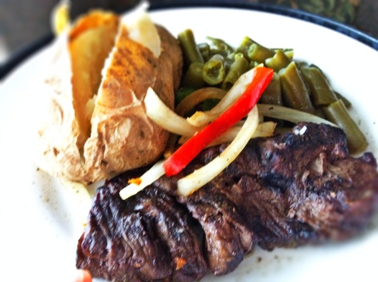 Strip steak, peppers & onions, green beans, and baked potato.